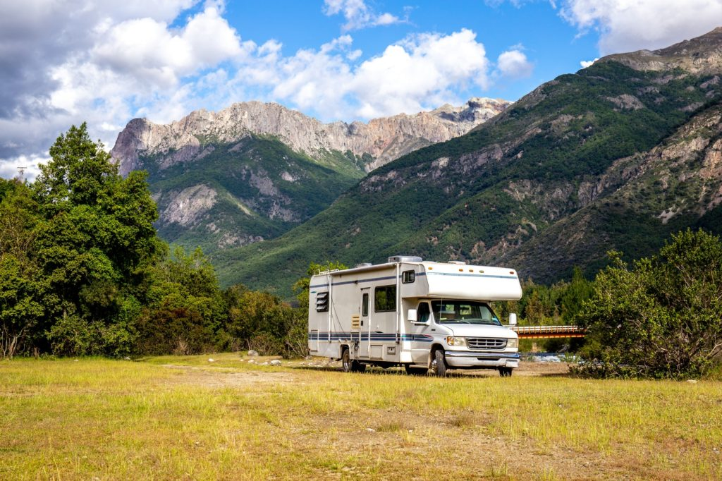 MOTORHOME RV In Chilean landscape in Andes. Family trip traval vacation in mauntains.